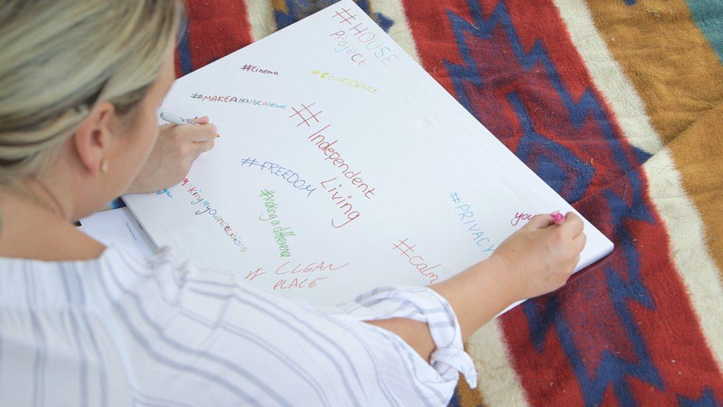 Woman writing on board
